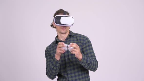 Thumbnail for Handsome Hipster Man Playing Games with Virtual Reality Headset