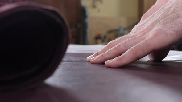 Close-up Shot of Craft Master Cutting Leather with Utility Knife. Handmade and Leatherwork Concept