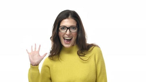 Slowmotion Cheerful and Outgoing Adult Mother in Glasses Modern Woman Saying Hi Informal Greeting