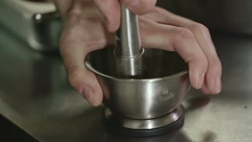 Grinding Pepper with Pestle