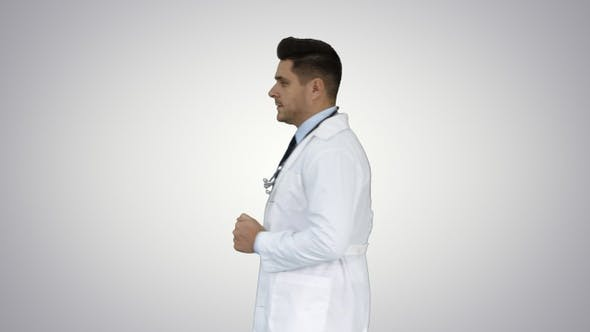 Thumbnail for Walking male doctor passing by on gradient background
