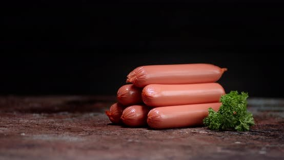 A Handful of Boiled Sausages with Herbs Slowly Rotates.