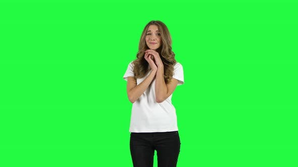 Thumbnail for Lovable Girl Looking with Tenderness and Folded Arms in Front of Her. Green Screen