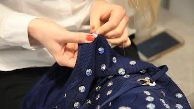 sewing on rhinestones