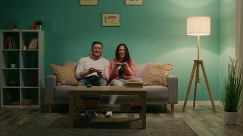 Woman and Man Are Entertaining at Home