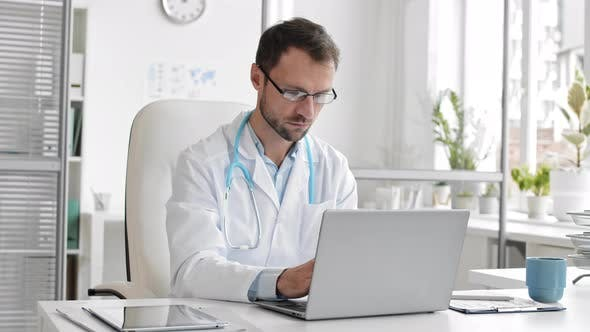 Thumbnail for Doctor Working on Laptop in the Office