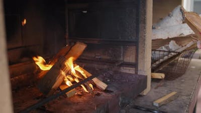 Unrecognizable Person Kindling Fire in Fireplace