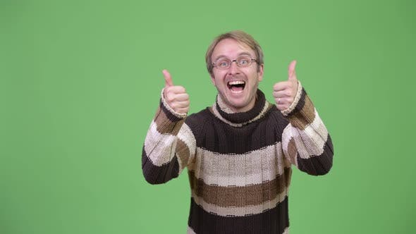 Thumbnail for Studio Shot of Happy Handsome Man Giving Thumbs Up and Looking Excited