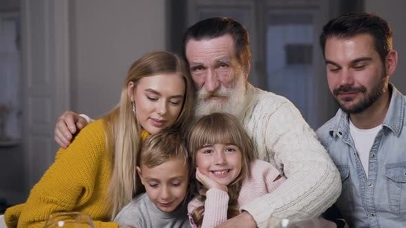 Thumbnail for Happy Bearded Man Hugging All His Attractive Joyful Family and Looking at Camera