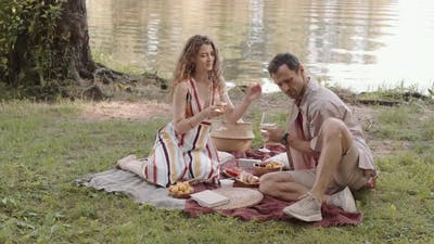 Couple on Picnic by Pond
