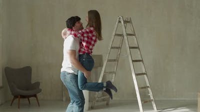 Young Couple Home Repair Singing and Dancing