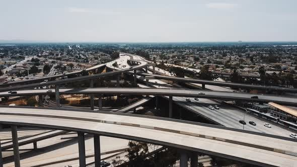 Thumbnail for Drone Flying Right Over Amazing Freeway Junction with Cars Going Through Many Road Levels, Bridges