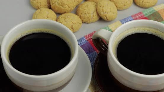 Thumbnail for Cookie and Two Cups of Coffee. Kruidnoten, Pepernoten, Strooigoed