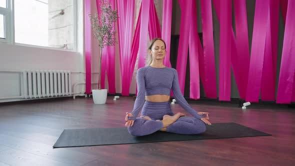 Yogi Woman Meditating in Lotus Position