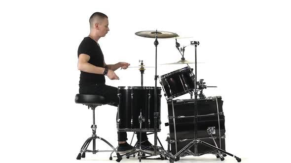 Thumbnail for Man Professionally Plays Percussion Instruments, White Background, Side View. Slow Motion