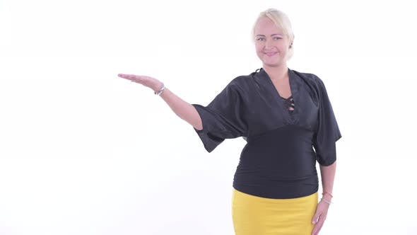 Thumbnail for Happy Blonde Businesswoman Showing Something