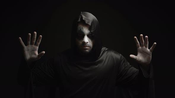 Dangerous Hell Demon Doing Magic Over Black Background
