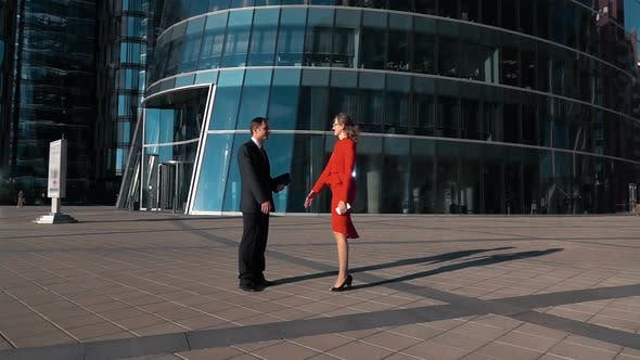 Thumbnail for Business Man and Woman Shaking Hands