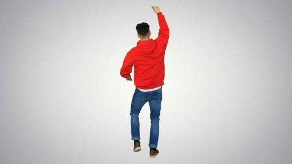 Thumbnail for Casual man dancing in a red hoody on gradient background.