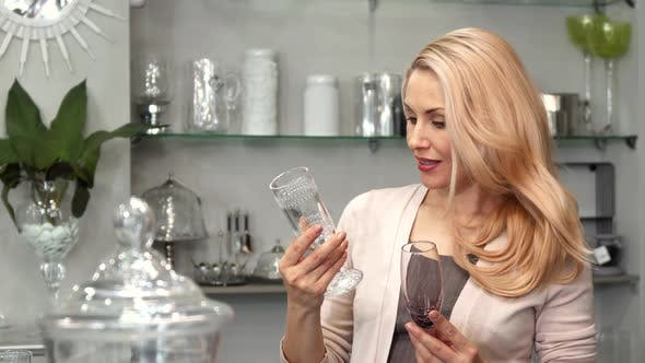 Creative Woman Chooses Glasses for Wine