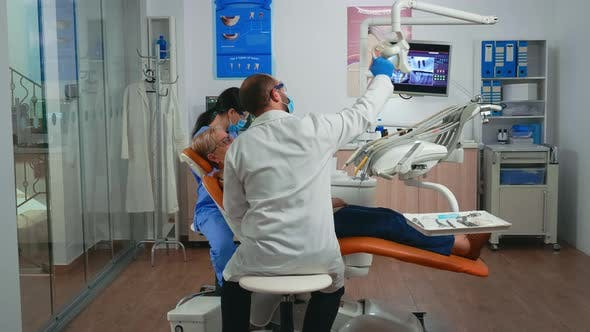 Thumbnail for Oral Surgeon Performing Surgery Installing Implant