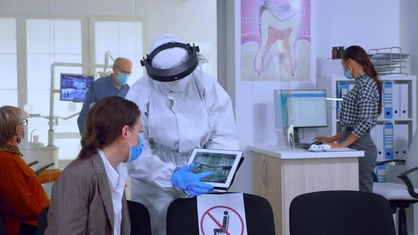 Thumbnail for Stomatologist in Protective Suit Pointing on Digital X-ray
