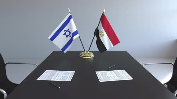 Flags of Israel and Egypt and Papers on the Table