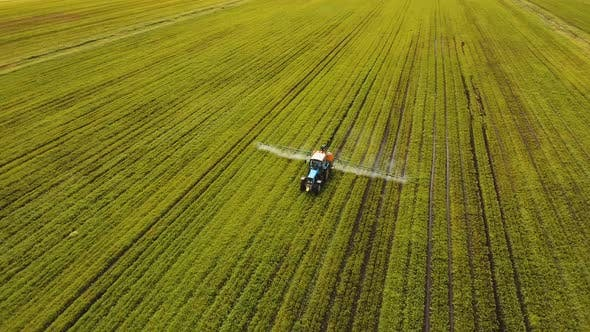 Thumbnail for Tractor Is Spraying Fertilizers Field.