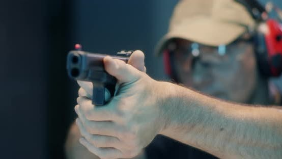 Thumbnail for Middle Aged Shooter Firing Pistol