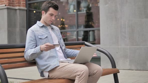 Cover Image for Online Shopping Failure for Young Man Sitting on Bench