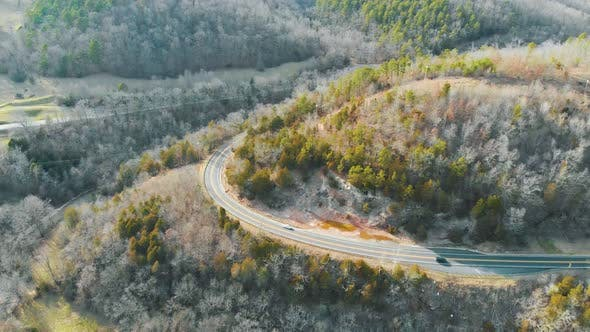 Thumbnail for Aerial of Cars Driving On Curvy Scenic Road
