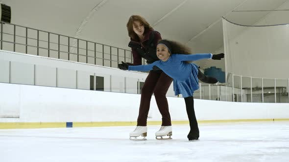 Thumbnail for Little Ice Dancer Practicing Skating on One Leg