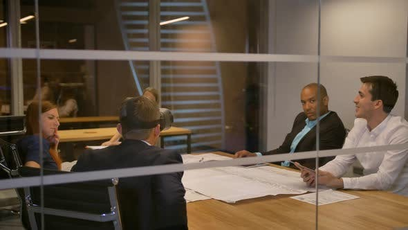 Thumbnail for Business Team Sitting at a Table, Man with Virtual Reality Goggles. People Testing Vr Headset in
