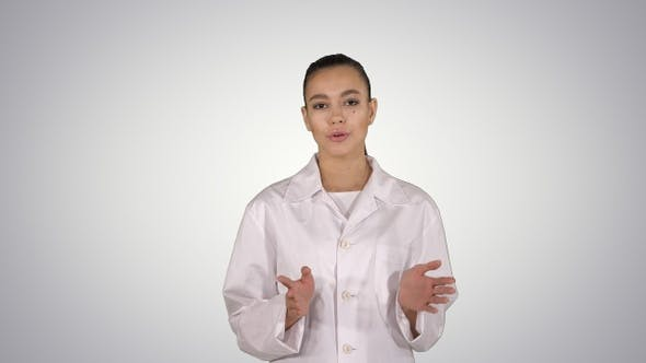 Cover Image for Woman doctor explaining and talking to camera while walking