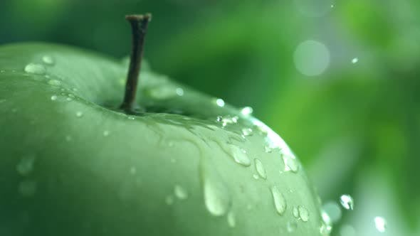 Extreme close-up of water drip on apple in slow motion; shot on Phantom Flex 4K at 1000 fps