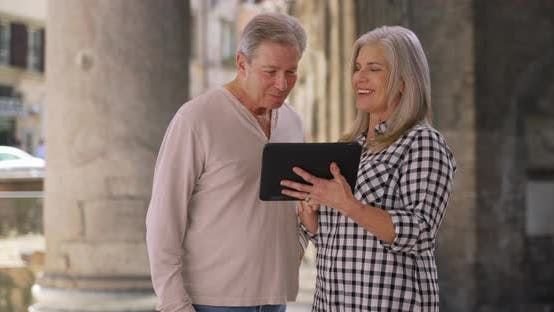 Thumbnail for Old white married male and female use tablet at Pantheon in Rome