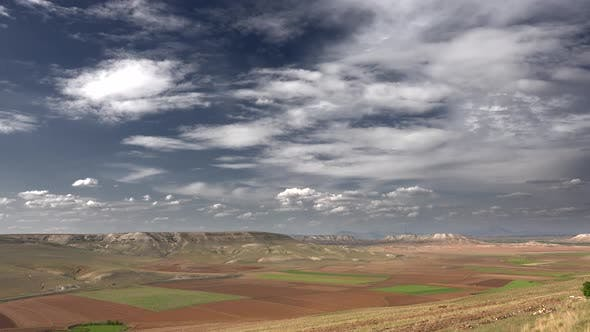 Thumbnail for Brown Fields and Large Valley Between Hills in Soft Mesa Mountain Topography