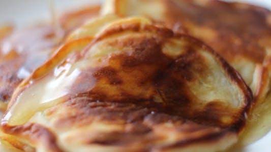 Thumbnail for Pouring Honey Over Pancakes