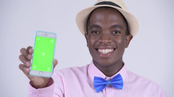 Cover Image for Face of Young Happy African Tourist Man Showing Phone