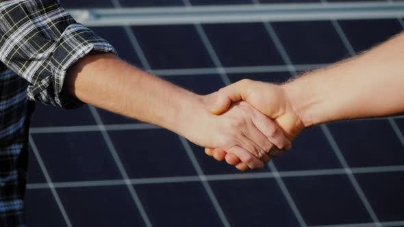 Thumbnail for Handshake of Two Businessmen on a Background Surface of Solar Panels