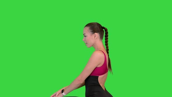Fitness Woman Doing Lunges and Losing Balance on a Green Screen Chroma Key