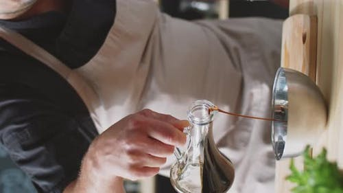 Chef Pouring Balsamic Vinegar into Bowl