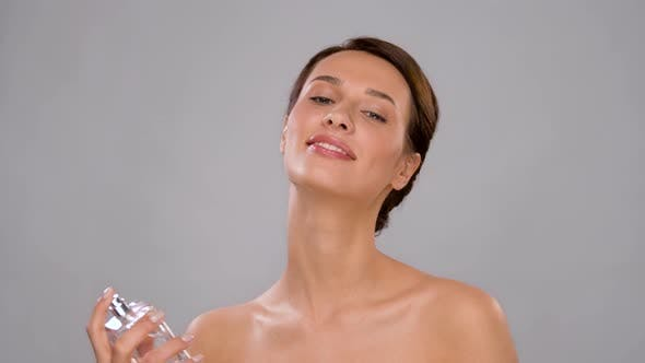 Thumbnail for Happy Woman Spraying Perfume Over Her Body