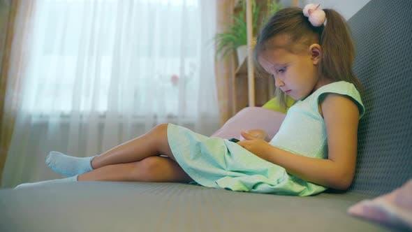 Thumbnail for Girl Child Preschooler Uses Smartphone