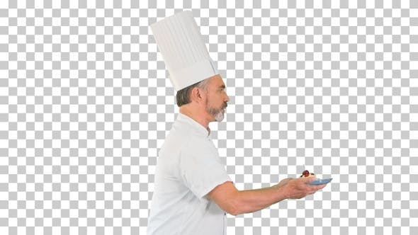Male pastry chef walking fast with dessert, Alpha Channel