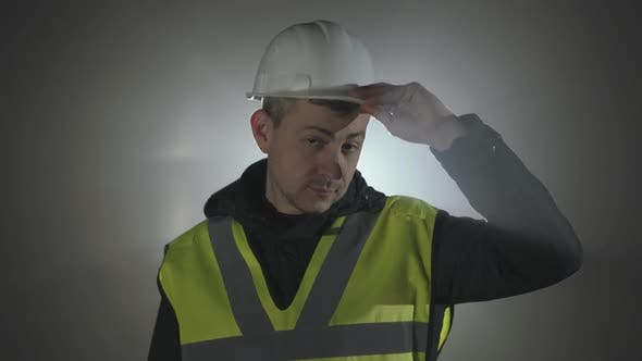 Thumbnail for Portrait Industrial Engineers in Hard Hat on a Black Background in the Spotlight.