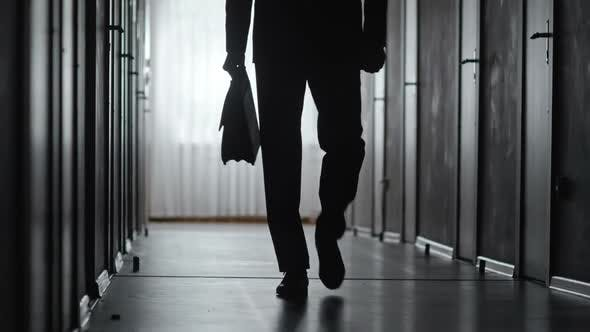 Thumbnail for Silhouette of Confident Man Walking along Hallway