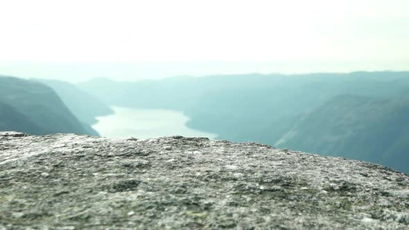 Thumbnail for Kjeragbolten's Surface and a Panoramic View of Rivers and Mountains