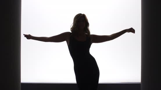 Thumbnail for Backlit slow motion woman doing a sexy dance