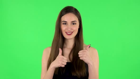 Thumbnail for Young Cheerful Woman Showing Thumbs Up, Gesture Like
